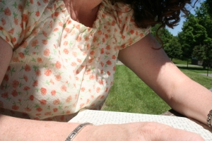 me, writing, outside in Minnesota, on a perfect day, in my brand-new blouse