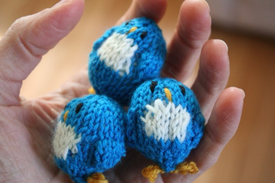 a handful of teeny penguins